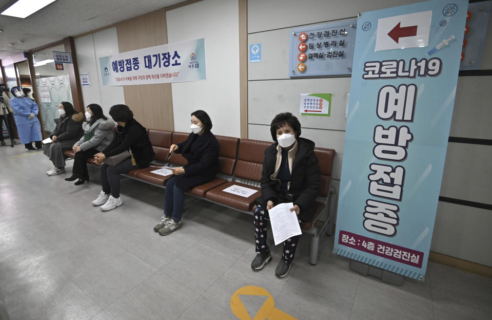 Nursing home workers wait to receive the first dose of the AstraZeneca COVID-19 vaccine at a health care center in Seoul Friday, Feb. 26, 2021. South Korea on Friday administered its first available shots of coronavirus vaccines to people at long-term care facilities, launching a mass immunization campaign that health authorities hope will restore some level of normalcy by the end of the year. (Jung Yeon-je /Pool Photo via AP)