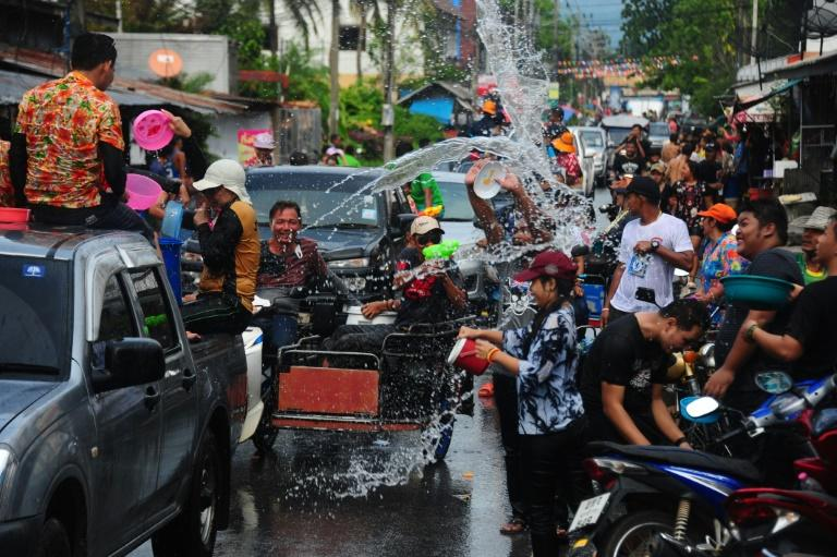 People take part in a water fight during Songkran, or Thai New Year, celebrations in the southern province of Narathiwat, on April 13, 2017