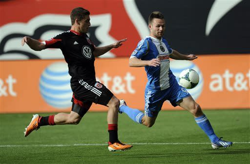 Philadelphia Union forward Jack McInerney, right, chases after the ball against D.C. United defender Chris Korb, left, during the first half of an MLS soccer game on Sunday, April 21, 2013, in Washington. (AP Photo/Nick Wass)