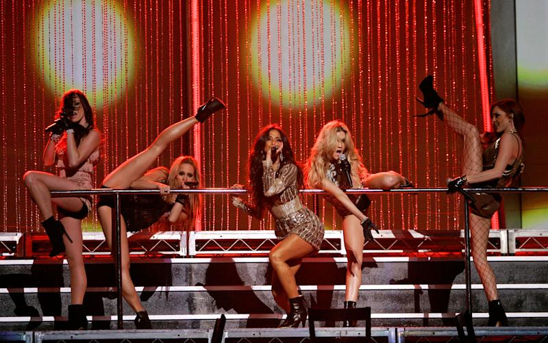 Pussycat Dolls perform at the 2006 American Music Awards in Los Angeles, on Tuesday, Nov. 21, 2006. (AP Photo/Kevork Djansezian)