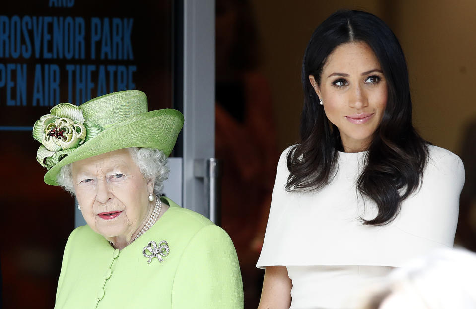 Queen Elizabeth II and the Duchess of Sussex arrive to visit Storyhouse Chester, where they will be taken on a tour of the building before unveiling a plaque to mark the official opening. (Photo by Martin Rickett/PA Images via Getty Images)