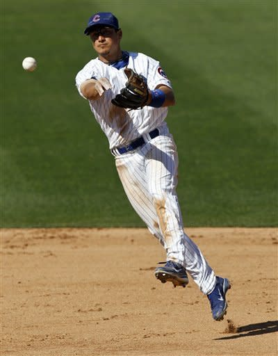 Chicago Cubs second baseman Darwin Barney throws out Cincinnati Zack Cozart out during the sixth inning of a MLB spring training baseball game in Mesa, Ariz., Monday, March 12, 2012. (AP Photo/Chris Carlson)