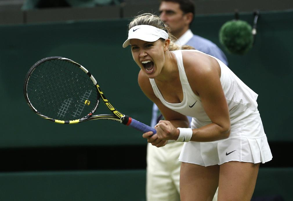 Eugenie Bouchard of Canada celebrates defeating Alize Cornet of France in their women's singles  match at the All England Lawn Tennis Championships in Wimbledon, London, Monday, June 30, 2014. (AP Photo/Pavel Golovkin)