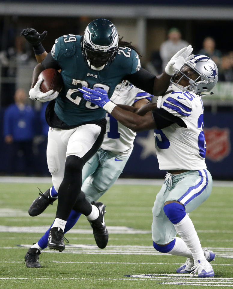 <p>Philadelphia Eagles running back LeGarrette Blount (29) breaks a tackle attempt by Dallas Cowboys' Xavier Woods (25) as LeGarrette carries the ball for long yardage in the second half of an NFL football game, Sunday, Nov. 19, 2017, in Arlington, Texas. (AP Photo/Michael Ainsworth) </p>