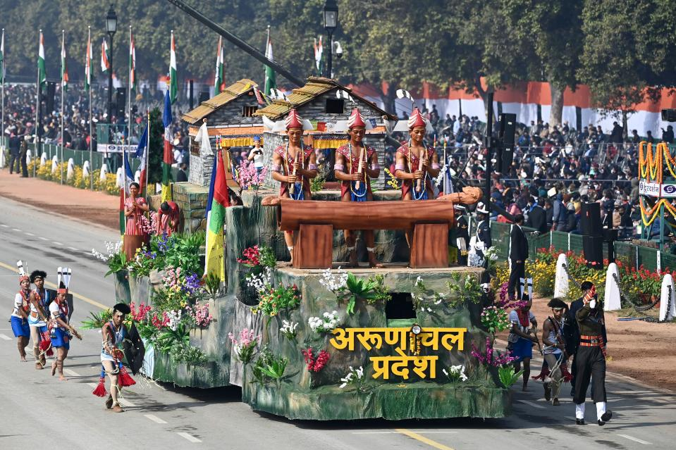 Performers dance next to a float representing Arunachal Pradesh state on Rajpath during the Republic Day parade in New Delhi on January 26, 2021. (Photo by Jewel SAMAD / AFP) (Photo by JEWEL SAMAD/AFP via Getty Images)