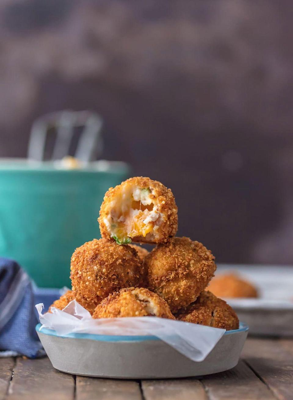 """<p>Who <em>wouldn't</em> love a fried mashed potato bite loaded with bacon and cheese?</p><p><strong>Get the recipe at <a href=""""https://www.thecookierookie.com/deep-fried-loaded-mashed-potato-bites/"""" rel=""""nofollow noopener"""" target=""""_blank"""" data-ylk=""""slk:The Cookie Rookie"""" class=""""link rapid-noclick-resp"""">The Cookie Rookie</a>.</strong> </p>"""