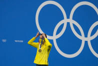 Emma Mckeon, of Australia, puts on her gold medal during a victory ceremony for the women's 50-meter freestyle final at the 2020 Summer Olympics, Sunday, Aug. 1, 2021, in Tokyo, Japan. (AP Photo/Jae C. Hong)