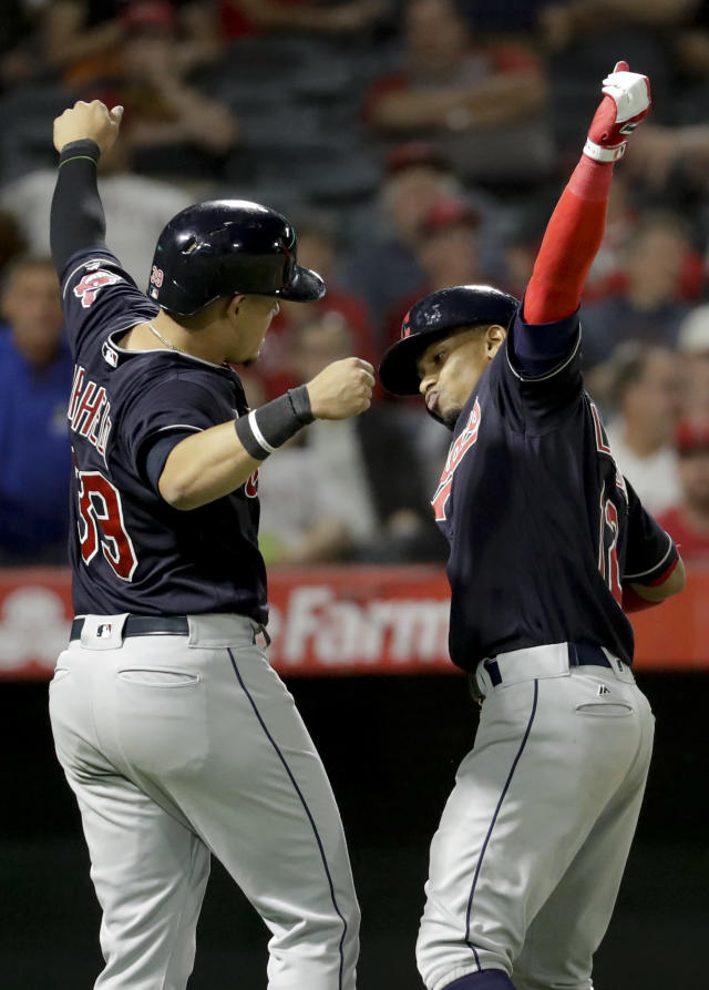 Cleveland Indians' Francisco Lindor, right, celebrates his two-run home run with Giovanny Urshela during the seventh inning of a baseball game against the Los Angeles Angels in Anaheim, Calif., Wednesday, Sept. 20, 2017. (AP Photo/Chris Carlson)