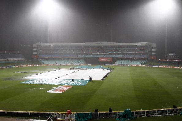 DURBAN, SOUTH AFRICA - OCTOBER 17:  The pitch is covered as rain and wind storms stop play during the Karbonn Smart CLT20 match between Kolkata Knight Riders and Perth Scorchers at Sahara Stadium Kingsmead on October 17, 2012 in Durban, South Africa.  (Photo by Anesh Debiky/Gallo Images/Getty Images)