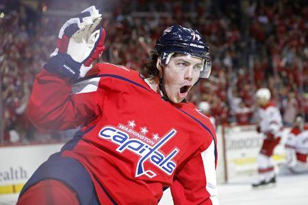 Apr 13, 2019; Washington, DC, USA; Washington Capitals right wing T.J. Oshie (77) celebrates after scoring a goal against the Carolina Hurricanes in the first period in game two of the first round of the 2019 Stanley Cup Playoffs at Capital One Arena. Mandatory Credit: Geoff Burke-USA TODAY Sports