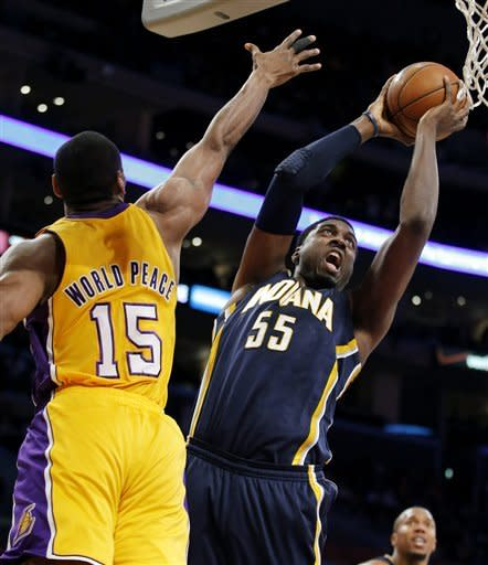 Indiana Pacers' Roy Hibbert (55) shoots against Los Angeles Lakers' Metta World Peace (15) in the first half of an NBA basketball game in Los Angeles, Tuesday, Nov. 27, 2012. (AP Photo/Jae C. Hong)