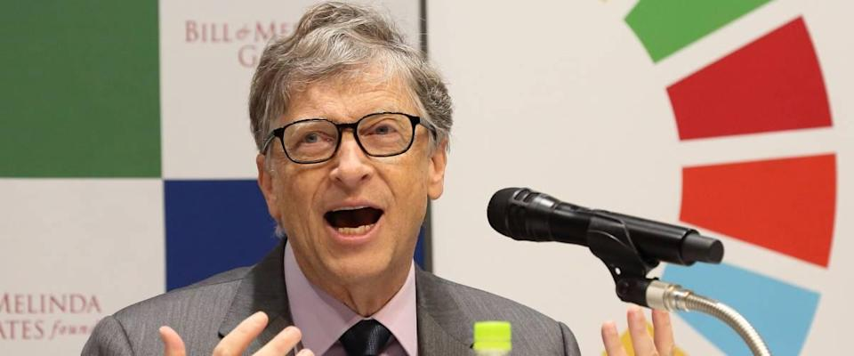 Bill Gates talking into microphone