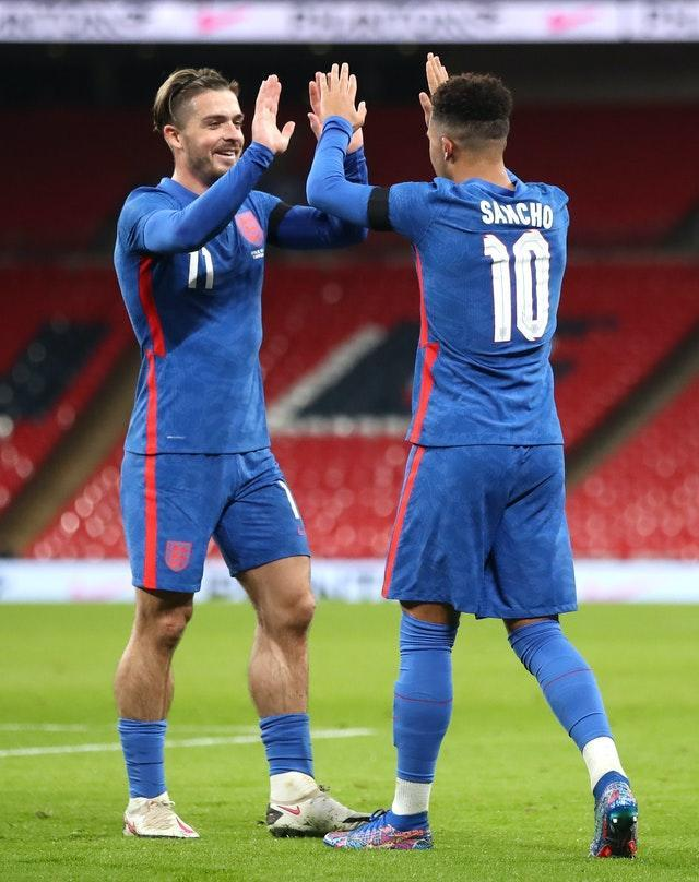 England's Jack Grealish (left) celebrates with Jadon Sancho after setting him up for their side's second goal