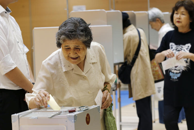 An elderly woman casts her vote in Japan's upper house parliamentary elections at a polling station in Tokyo, Sunday, July 21, 2013. Japanese voters went to the polls Sunday in an upper house of parliament election expected to give Prime Minister Shinzo Abe's ruling coalition a strong mandate as he pushes ahead with economic reforms and his conservative political agenda. (AP Photo/Koji Sasahara)