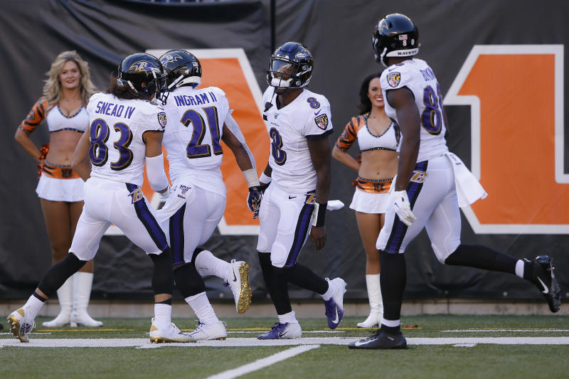 Baltimore Ravens quarterback Lamar Jackson (8) celebrates his touchdown during the second half of NFL football game against the Cincinnati Bengals, Sunday, Nov. 10, 2019, in Cincinnati. (AP Photo/Gary Landers)