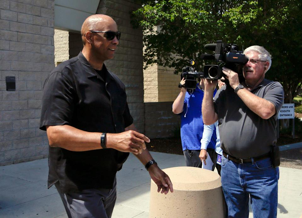 Former NFL football player Kellen Winslow, left, leaves an arraignment for his son, former NFL football player Kellen Winslow Jr., Friday, June 15, 2018, in Vista, Calif. Winslow Jr., a former tight end, was arrested Thursday on charges of rape and other sex crimes, the day he was to appear in court on an unrelated burglary charge. (AP Photo/Gregory Bull)