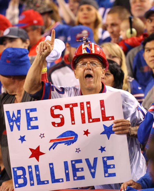 FILE - In this Sept. 15, 2016, file photo, Buffalo Bills fans cheer during the first half of an NFL football game against the New York Jets in Orchard Park, N.Y. It has never been easy being a sports fan in Buffalo, where losing has been customary. A renewed sense of hope has suddenly arisen in this rust-belt city after the Bills selected quarterback Josh Allen in the first round of the draft and the Sabres won the NHL draft lottery. (AP Photo/Bill Wippert, File)