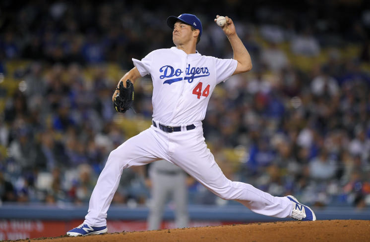Veteran Rich Hill picked up the win as the Dodgers clinched the NL West. (AP)