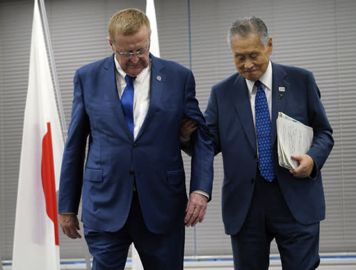 FIEL - In this Sept. 12, 2018, file photo, John Coates, left, chairman of the IOC Coordination Commission for the 2020 Tokyo Olympics and Paralympics and Tokyo Olympic organizing committee President Yoshiro Mori walk out from the venue of the IOC and Tokyo 2020 joint press conference in Tokyo. The price tag keeps soaring for the 2020 Tokyo Olympics despite local organizers and the International Olympic Committee saying that spending is being cut. (AP Photo/Eugene Hoshiko, File)