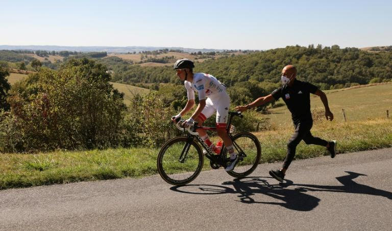 Broken dreams: Tadej Pogacar had to switch bikes and lost contact with the leading group