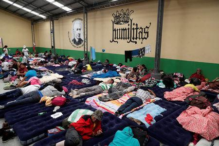 Honduran migrants, part of a caravan trying to reach the U.S., rest at a migrant shelter in Guatemala City, Guatemala October 17, 2018. REUTERS/Luis Echeverria