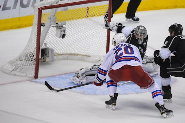 New York Rangers left wing Chris Kreider (20) scores as Los Angeles Kings goalie Jonathan Quick, right, looks on during the second period in Game 5 of the NHL Stanley Cup Final series Friday, June 13, 2014, in Los Angeles. (AP Photo/Mark J. Terrill)