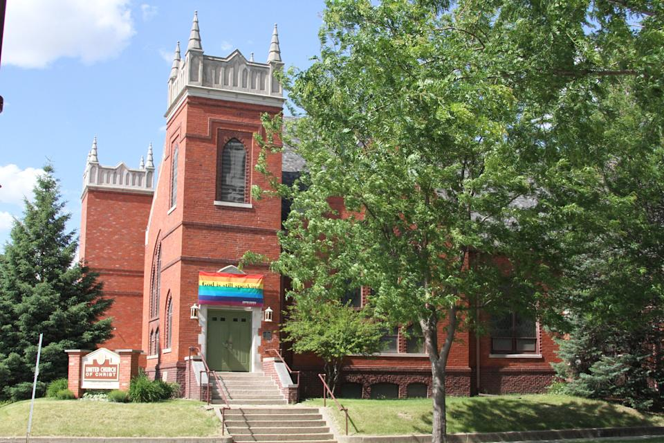 """The United Church of Christ is seen in Ames, Iowa. The banner above the doorway reads """"God is still speaking."""" The banner was stolen and lit on fire on early Tuesday morning."""