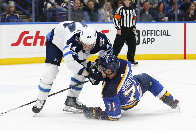 Winnipeg Jets' Josh Morrissey, left, checks St. Louis Blues' Vladimir Sobotka, of the Czech Republic, to the ice during the second period of an NHL hockey game Friday, Feb. 23, 2018, in St. Louis. (AP Photo/Billy Hurst)