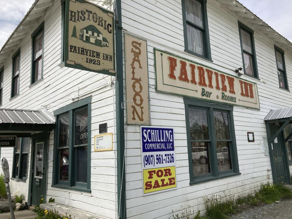 FILE - This June 2, 2020, file photo shows a For Sale sign at the Fairview Inn in Talkeetna, Alaska. Tourism is one of the main drivers of the Alaska economy, which means some businesses are suffering during the pandemic. Communities across Alaska are feeling the financial squeeze, from cruise ship ports where major lines have canceled summer sailings. Talkeetna, bills itself as the Gateway to Denali, where the ship passengers arrive on buses for inland excursions. Nearly half of the state's 2.2. million annual visitors usually arrive on those vessels. (AP Photo/Mark Thiessen, File)