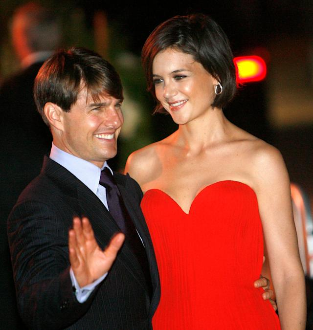 Tom Cruise and Katie Holmes pose at a party at the Museum of Contemporary Art in Los Angeles on July 22, 2007.