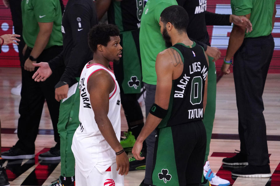 Kyle Lowry, left, shares a word with the Celtics' Jayson Tatum after Game 7 Friday night. (AP Photo/Mark J. Terrill)