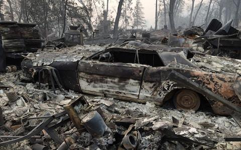 A property reduced to ashes is seen in Paradise, California - Credit: AFP