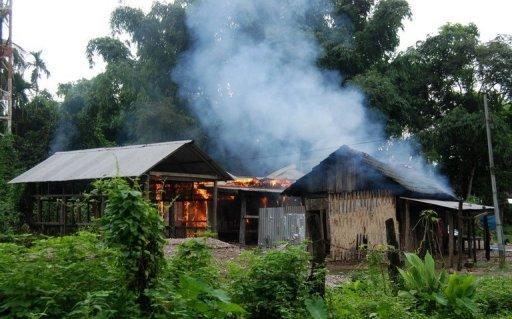A house burns at Kachugaon village during the clashes on July 23