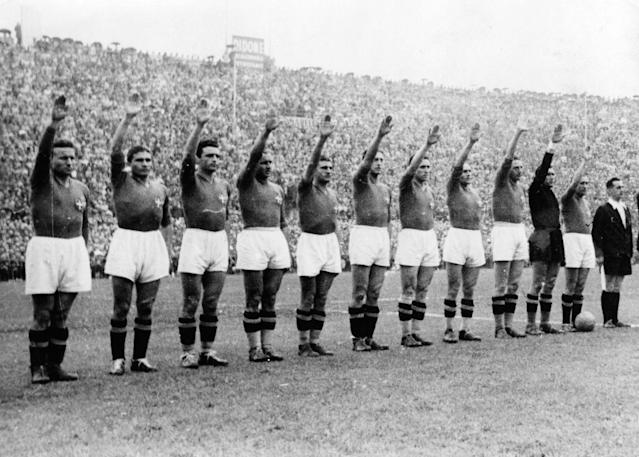 FILE - In this June 19, 1938 file photo, the Italian soccer team perform the fascist salute in Colombes Stadium, Paris, before the start of the World Cup soccer final match against Hungary. Earlier in the tournament that was taking place amid the drumbeat of war, the team caused consternation by wearing black shirts in a match. The 21st World Cup begins on Thursday, June 14, 2018, when host Russia takes on Saudi Arabia. (AP Photo/File)