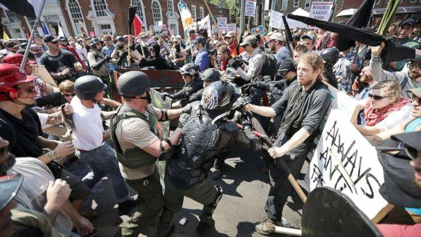 PHOTO: White nationalists, neo-Nazis and members of the 'alt-right' clash with counter-protesters as they enter Lee Park during the 'Unite the Right' rally, Aug. 12, 2017, in Charlottesville, Va. (Chip Somodevilla/Getty Images)