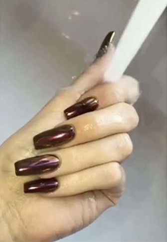 <p>Forever trying crazy nail colors, Kylie rocked the most unexpected metallic hue: brown. The chocolate mani is so glam.</p>