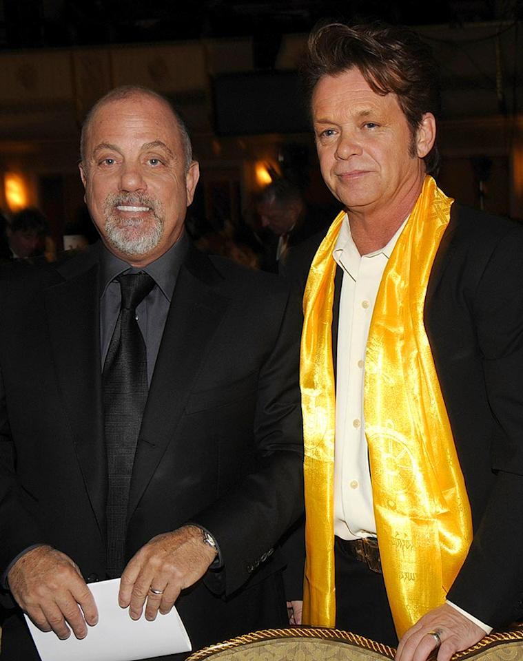 "Billy Joel poses with John Mellencamp after inducting him into the Rock and Roll Hall of Fame. Kevin Mazur/<a href=""http://www.wireimage.com"" target=""new"">WireImage.com</a> - March 10, 2008"