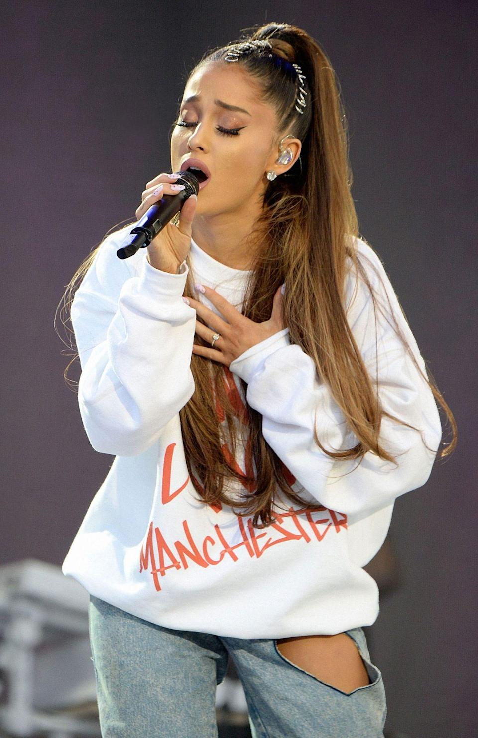 """<p>After the deadly <a href=""""https://people.com/crime/ariana-grande-concert-manchester-arena-incident/"""" rel=""""nofollow noopener"""" target=""""_blank"""" data-ylk=""""slk:May 2017 terrorist attack"""" class=""""link rapid-noclick-resp"""">May 2017 terrorist attack</a> that left 22 dead and 59 injured at Manchester Arena in the U.K. where Grande was performing a concert, the star vowed to come back to organize a <a href=""""https://people.com/music/ariana-grande-letter-fans-manchester-concert-attack/"""" rel=""""nofollow noopener"""" target=""""_blank"""" data-ylk=""""slk:benefit concert to honor and raise money for the victims"""" class=""""link rapid-noclick-resp"""">benefit concert to honor and raise money for the victims</a> and their families. She made it happen a month later and enlisted friends Miley Cyrus, Pharrell Williams, Little Mix, the Black Eyed Peas, Justin Bieber and more to play at her <a href=""""https://people.com/music/ariana-grande-benefit-concert-photos/"""" rel=""""nofollow noopener"""" target=""""_blank"""" data-ylk=""""slk:One Love Manchester"""" class=""""link rapid-noclick-resp"""">One Love Manchester</a> show.</p>"""