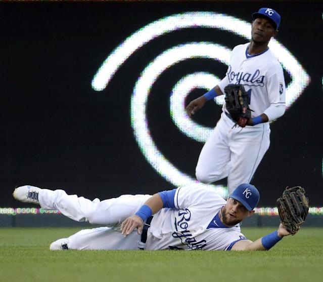 Kansas City Royals left fielder Alex Gordon catches a fly ball for the out on Oakland Athletics' Jed Lowrie during the second inning of a baseball game Monday, Aug. 11, 2014, in Kansas City, Mo. (AP Photo/Charlie Riedel)