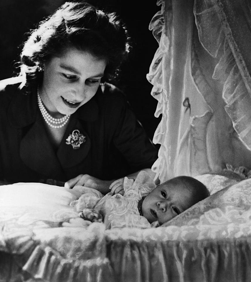 <p>Princess Elizabeth, future Queen Elizabeth II, is shown gazing at her month-old son Prince Charles. (Photo: Getty Images) </p>