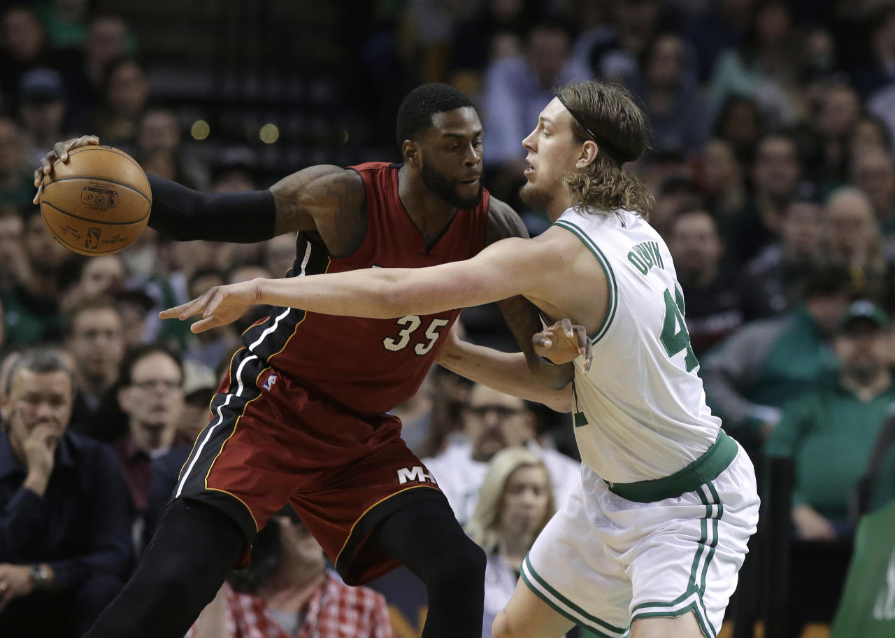Willie Reed, then of the Miami Heat, tries to score against Kelly Olynyk, then of the Boston Celtics. (AP)