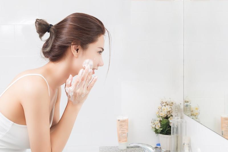 woman cleaning face skin enjoy herself with bubble cleansing foam