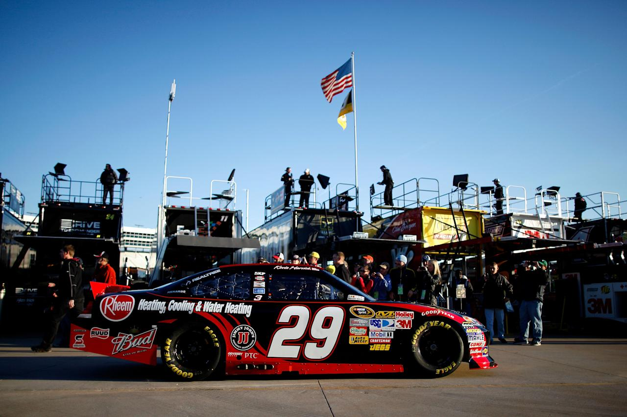 FORT WORTH, TX - NOVEMBER 05:  Kevin Harvick, driver of the #29 Rheem Chevrolet, drives through the garage area during practice for the NASCAR Sprint Cup Series AAA Texas 500 at Texas Motor Speedway on November 5, 2011 in Fort Worth, Texas.  (Photo by Chris Graythen/Getty Images)