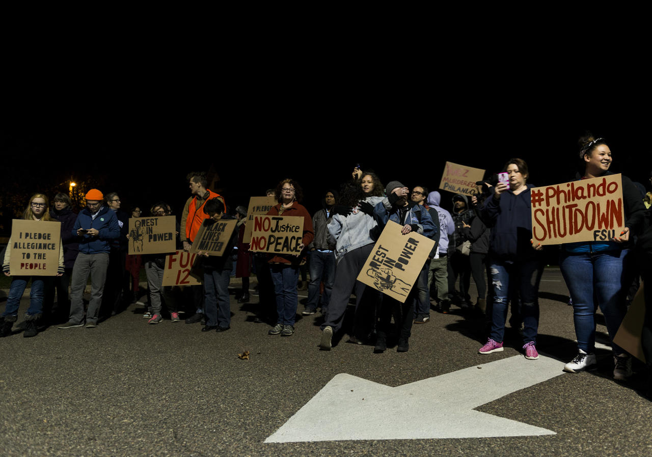 <p>People gather at JJ Hill Montessori school, where Philando Castile worked, on November 16, 2016 in St. Paul, Minn. Ramsey County Attorney John Choi filed charges today against St. Anthony Police Officer Jeronimo Yanez who shot and killed Castile during a traffic stop this past July. (Stephen Maturen/Getty Images) </p>