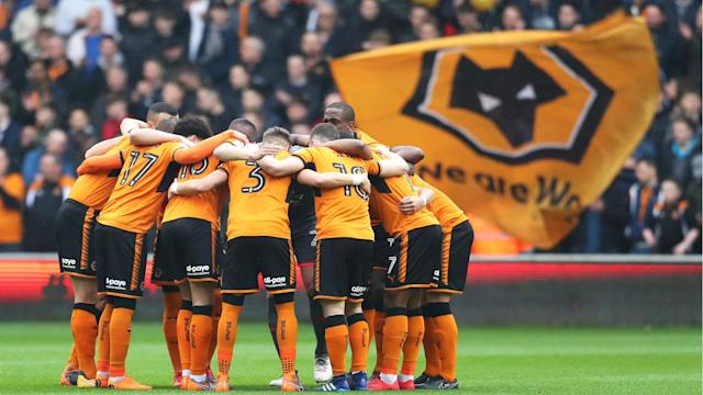 Diogo Jota and Benik Afobe scored in each half as Wolves marked their return to the top flight in style against Birmingham City.