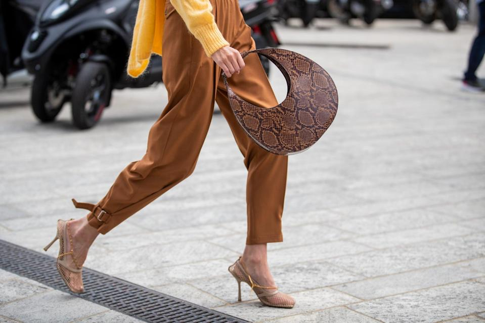 <p>As the return of the shoulder bag continues to pick up momentum, trendsetters are turning to more than just petite baguettes. The moon-bag trend gained momentum at the close of 2019 during Fashion Week, but it seems it's truly just getting started. Staud extended its original Moon Bag into soft-pleated iterations, Coperni's elongated shoulder bags have garnered a cult following, and many other brands are presenting unique takes on the trend (such as Peju Obasa's oak-ring handles).</p>