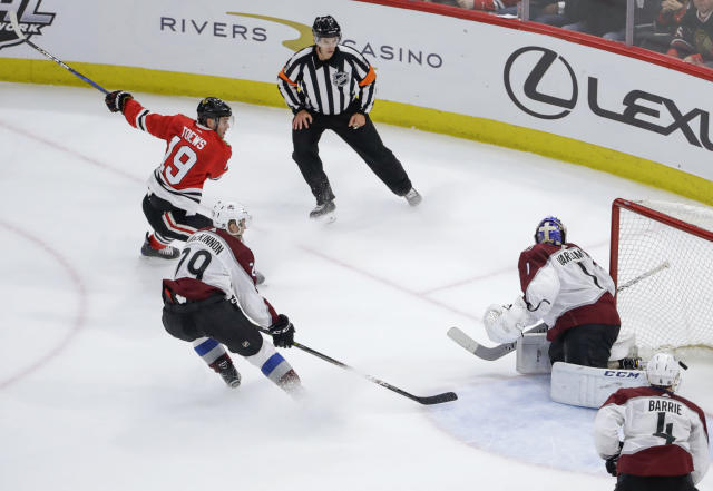 Chicago Blackhawks center Jonathan Toews (19) scores past Colorado Avalanche goaltender Semyon Varlamov (1) during overtime in an NHL hockey game Tuesday, March 6, 2018, in Chicago. Chicago won 2-1. (AP Photo/Kamil Krzaczynski)