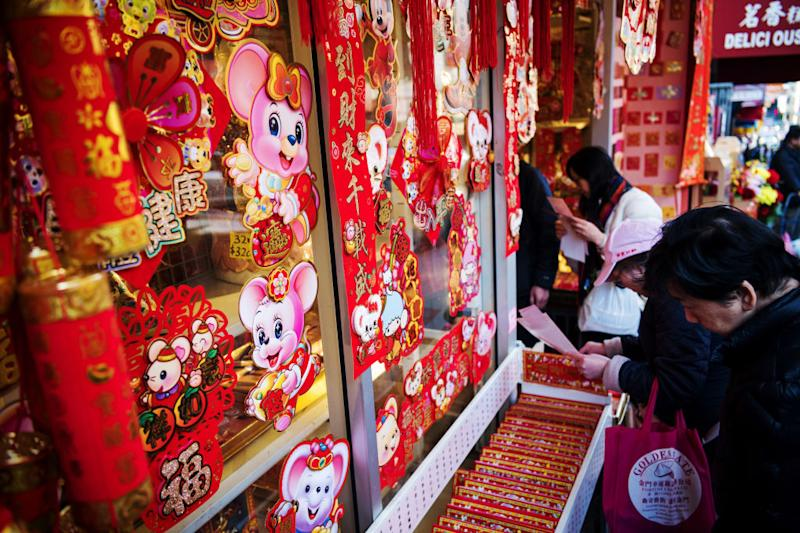 Shoppers browse year of the rat decorations ahead of Lunar New Year in the Chinatown neighborhood of San Francisco, California, U.S., on Wednesday, Jan. 22, 2020. Also known as Chinese New Year or the Spring Festival, it marks the beginning of the lunar calendar and is China's most important holiday, a period that's seen as celebrating values like unity and family ties. Photographer: David Paul Morris/Bloomberg