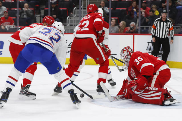Detroit Red Wings goaltender Jimmy Howard (35) stops a Montreal Canadiens right wing Dale Weise (22) shot in the first period of an NHL hockey game, Tuesday, Feb. 26, 2019, in Detroit. (AP Photo/Paul Sancya)