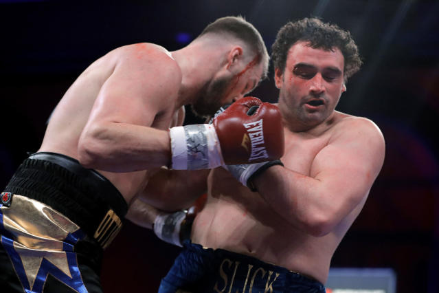 FILE - In this Saturday, April 13, 2019 file photo, Otto Wallin, left, fights Nick Kisner during the first round of a heavyweight boxing bout Saturday, April 13, 2019, in Atlantic City, N.J. Swedish heavyweight Otto Wallin will take his first step into big-time boxing when he fights Tyson Fury in Las Vegas on Saturday Sept. 14, 2019. A win for Wallin would be a big shock because the unbeaten Fury is the lineal champion and perhaps is the best heavyweight out there. (AP Photo/Julio Cortez, File)